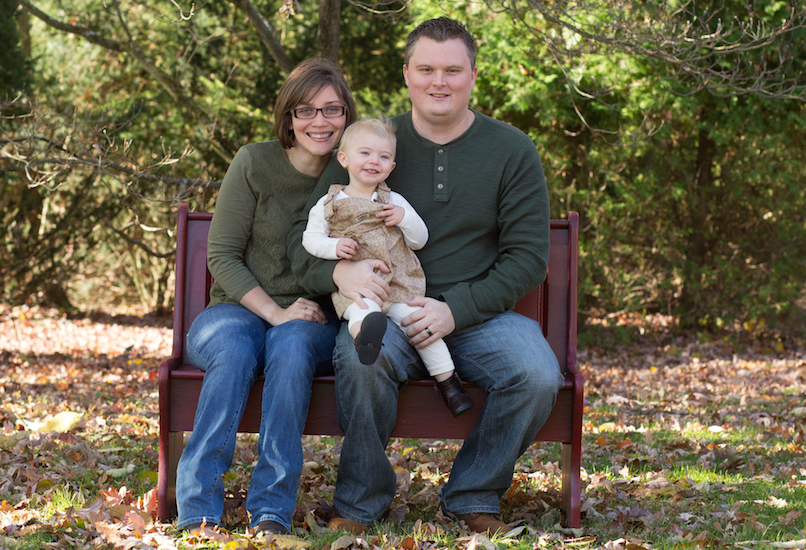 Michelle Keller with her family on a bench outdoors