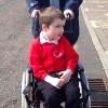 Miriam's son in a wheelchair
