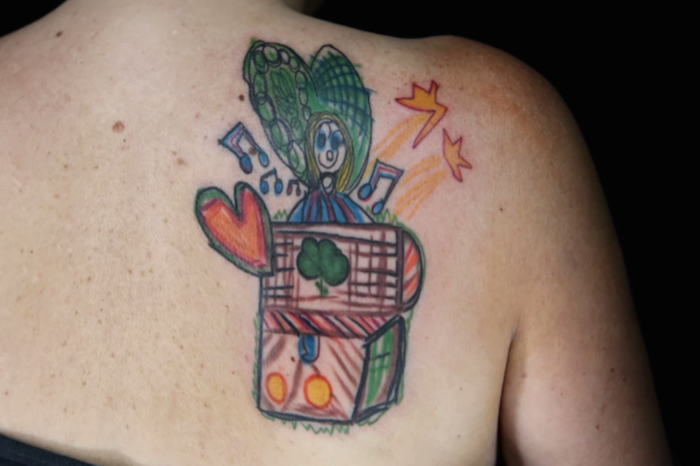 colorful jack in the box tattoo on back shoulder