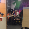 McDonald's employee helps man with disabilities eat his food