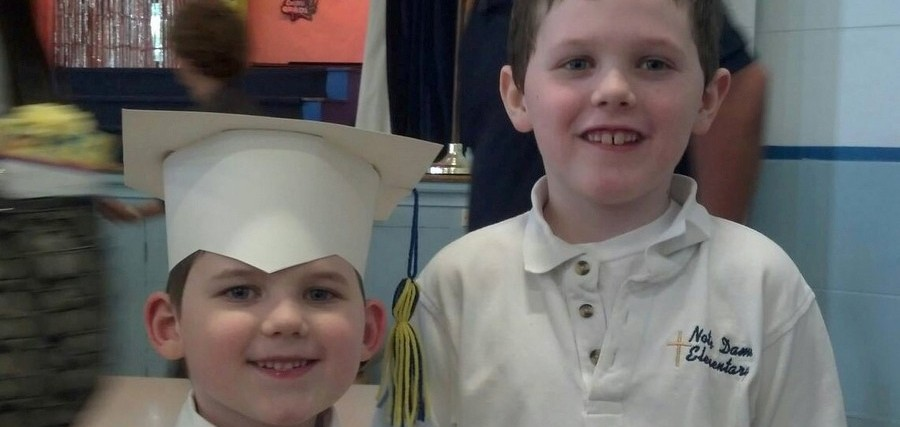 two brothers during a graduation ceremony
