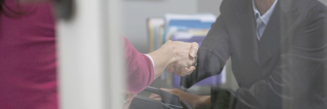 two women shaking hands in an office