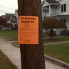 A sign that says, 'Attention Parents' on street light