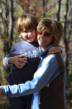 author and her son in the woods hiking