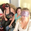 "Caitlin's description of the image: ""A selfie a sighted friend took when she and three other sighted friends put on blindfolds and watched a movie with me using video description."""