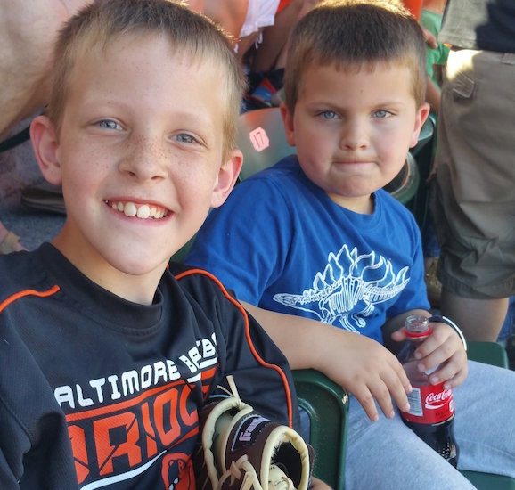 two young boys in a stadium