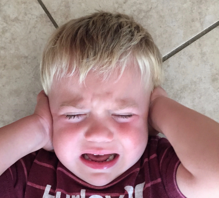author's son crying, covering ears