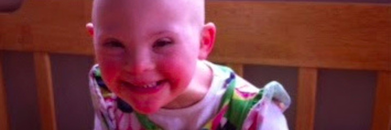 author's daughter smiling at the kitchen table