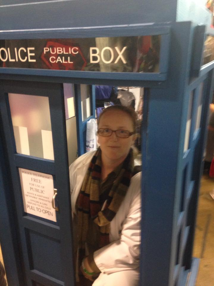 A woman in a phone booth.