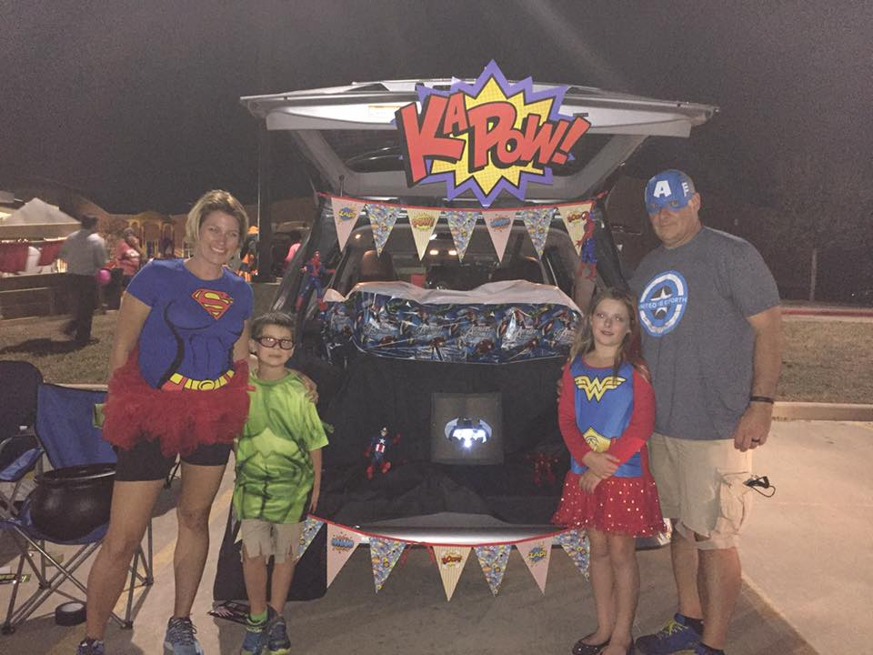 A family dressed like superheroes.