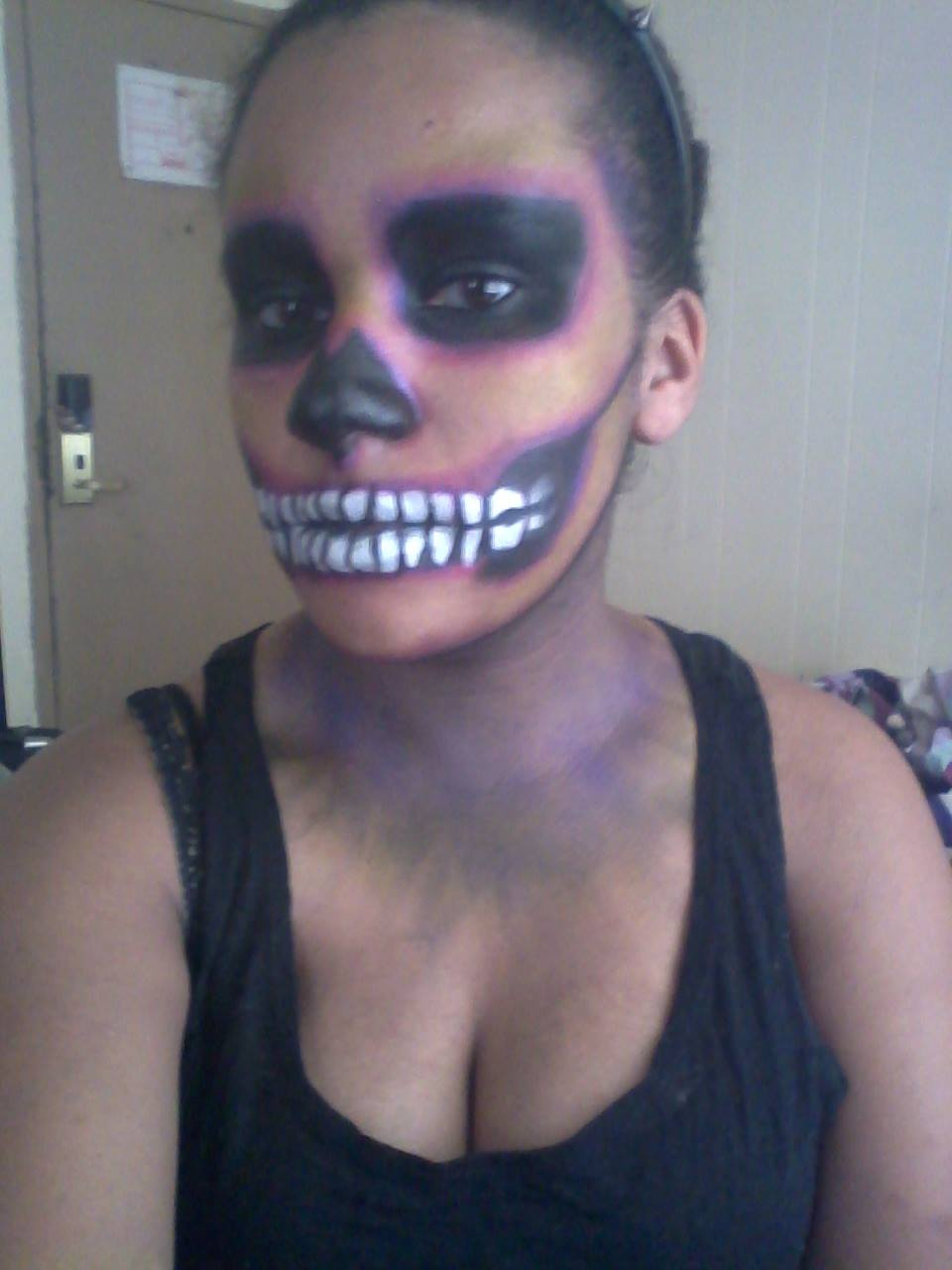 A woman with Halloween makeup on.
