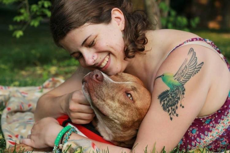 A tattoo of a hummingbird on a woman's arm