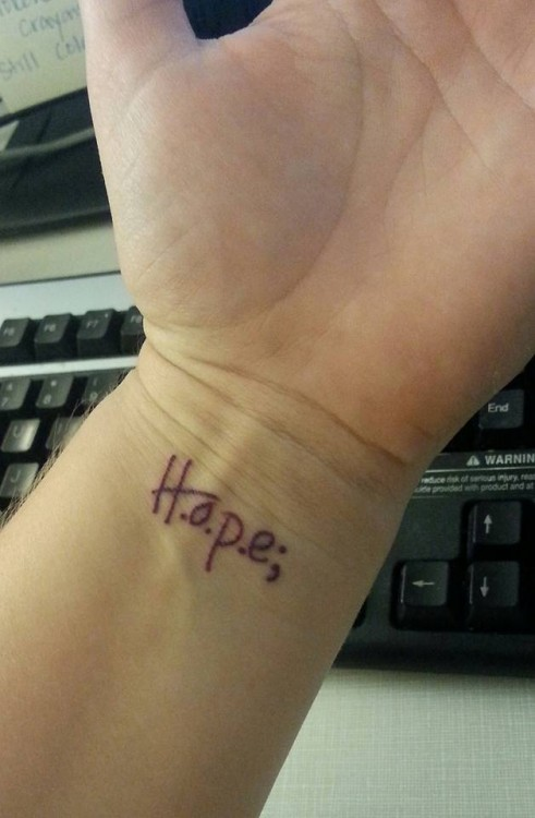 "A tattoo of the word ""H.o.p.e;"""