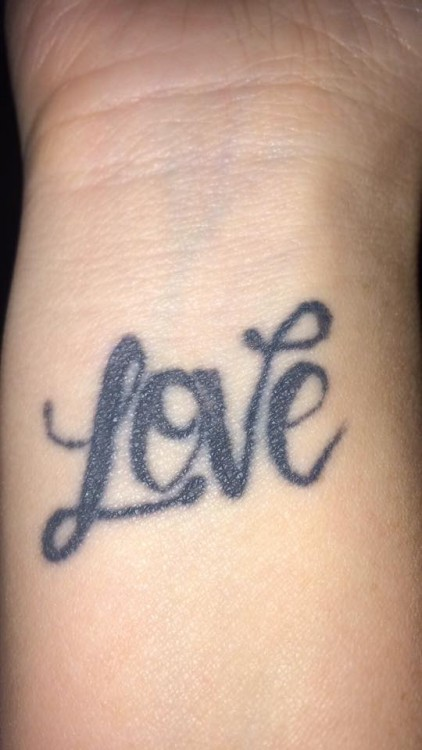 "A tattoo of the word ""Love"""