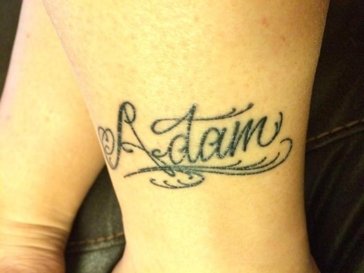 "A tattoo of the name ""Adam"""