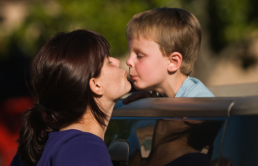 mom about to kiss son