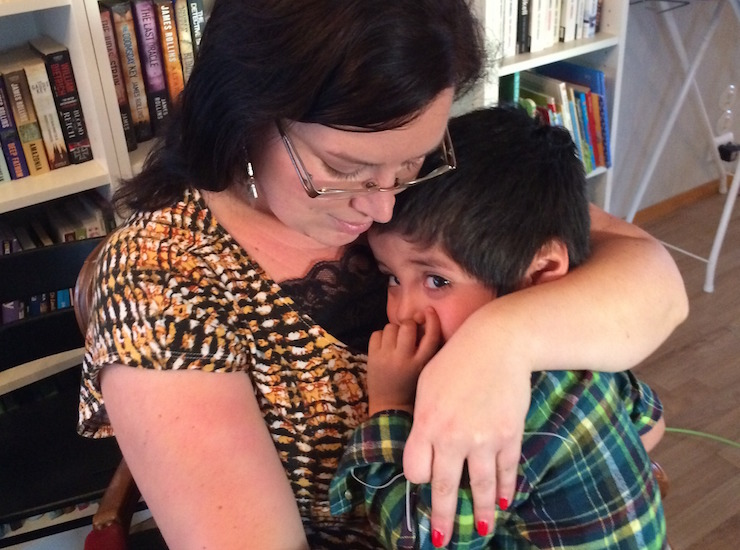 author hugs her adopted son