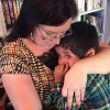 author hugging her adopted son