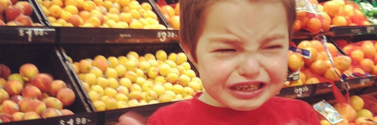 Kathy's son Isaac in the grocery store