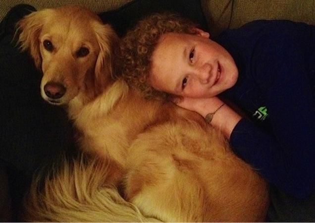 boy laying next to his dog