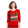 Woman wearing red sweater that says, 'OCD: Obsessive Christmas Disorder'