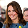 A close up photo of a Kate Middleton smiling