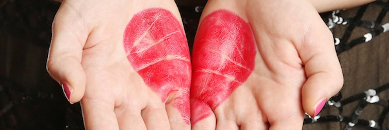 Heart shape drawn on female palms