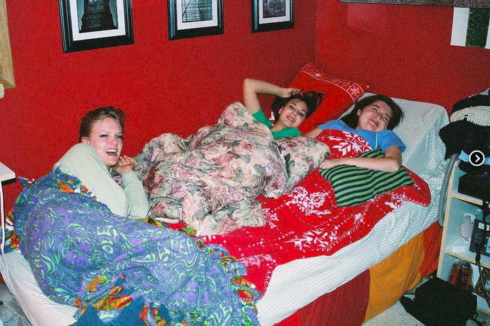 girls laying in bed at a sleepover