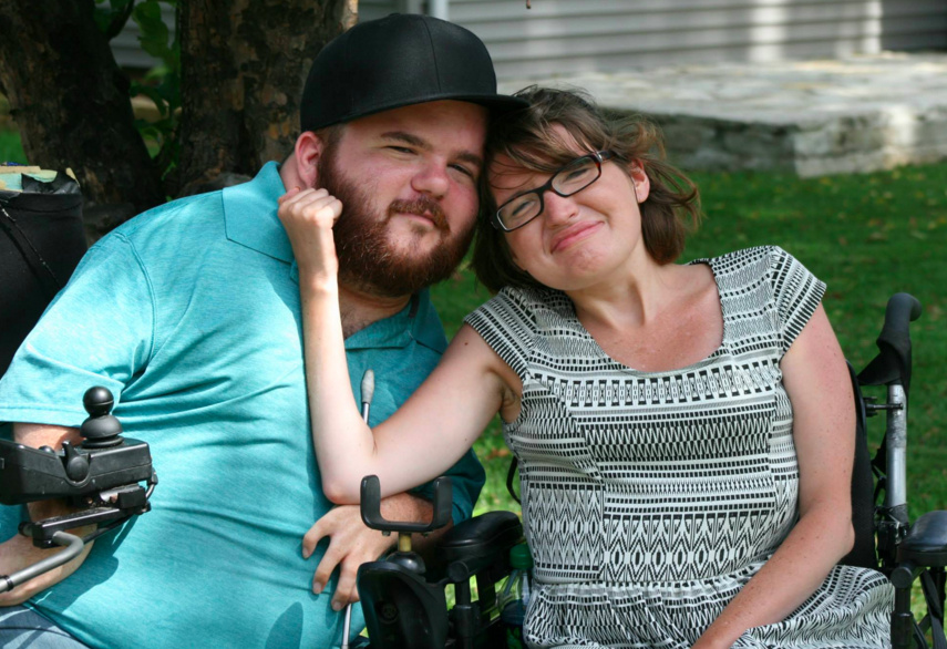 woman and man in wheelchairs