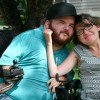 man and woman in wheelchairs