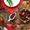 High angle view of rustic dinner table with berries