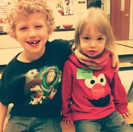 Brock with his arm around his sister