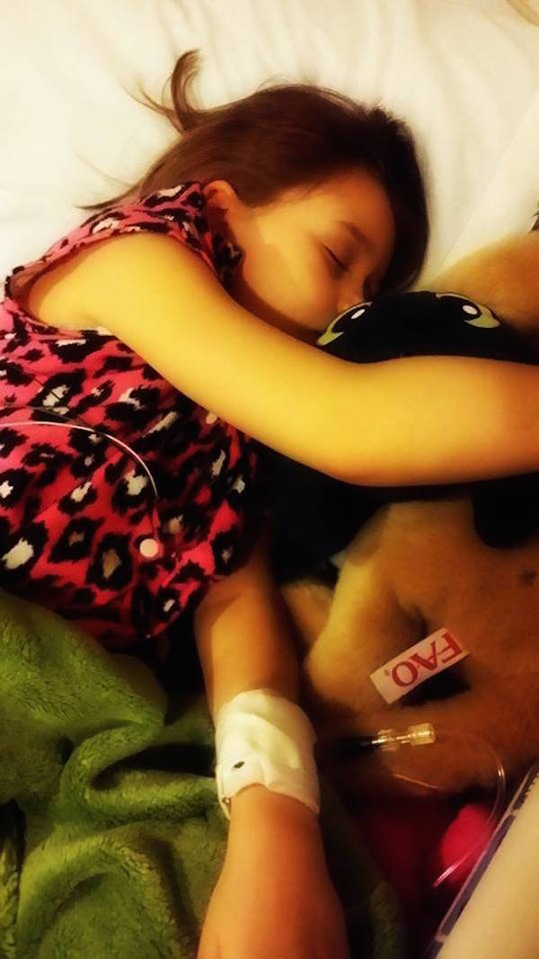 little girl sleeping in the hospital