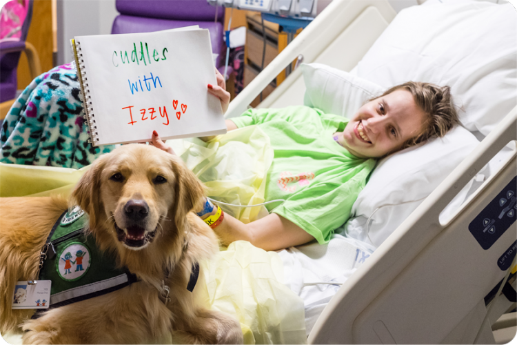 Megan spent 150 days in the hospital but found a new friend in Izzy the therapy dog.
