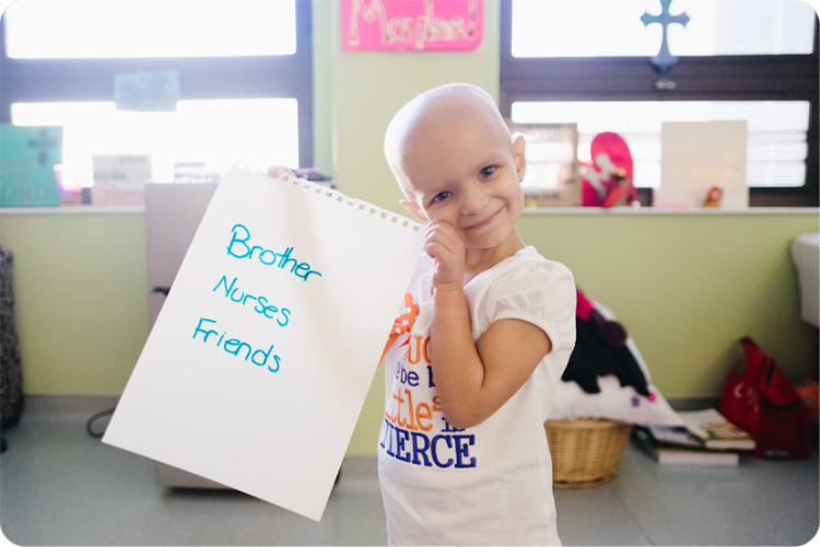 "patient holds sign saying ""brother, nurses, friends."""