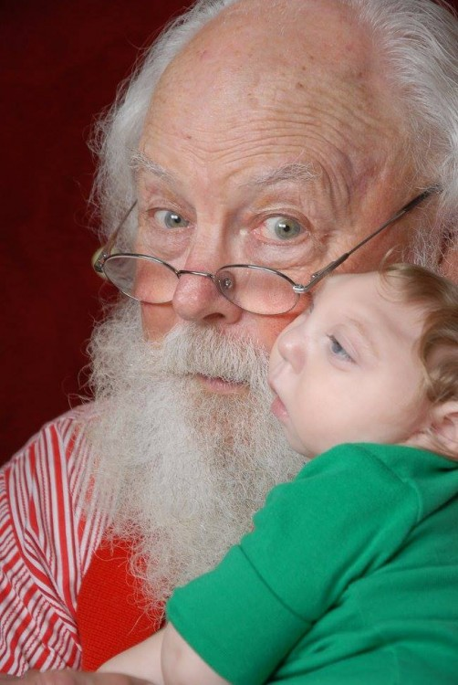 Santa looking at the camera with author's son