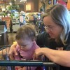Cindy, a Ralph's clerk with Down syndrome, teaching the author's child sign language in the store.