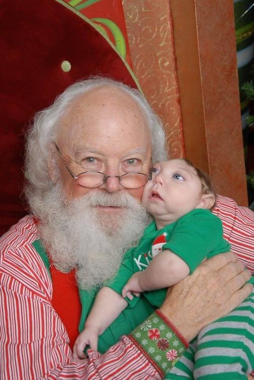 santa holding author's son
