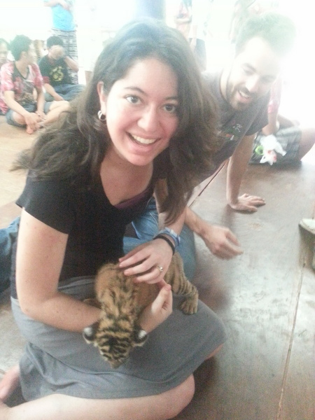 ​Holding a baby tiger in Thailand is a good type of stress.