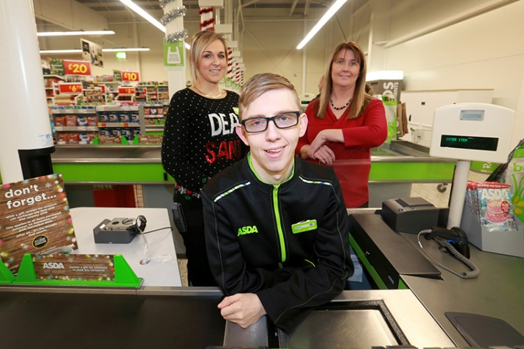 Asda Altrincham Asda Service Section Leader Sophie Rutherford and Ingeus Regional Account Co-ordinator Natalie Burney with new recruit Tom Stephens. credit: leeboswellphotography.com