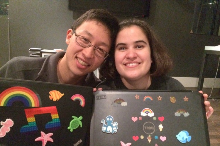 Eric and Caitlin decorating laptops with tactile stickers.