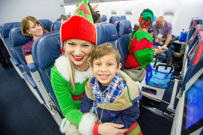 on board a Delta flight to the North Pole during the North Pole Fantasy flight at Hartsfield Jackson International Airport on Saturday December 5, 2015. ©2015 Chris Rank/ Rank Studios