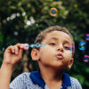 Boy playing with bubbles.