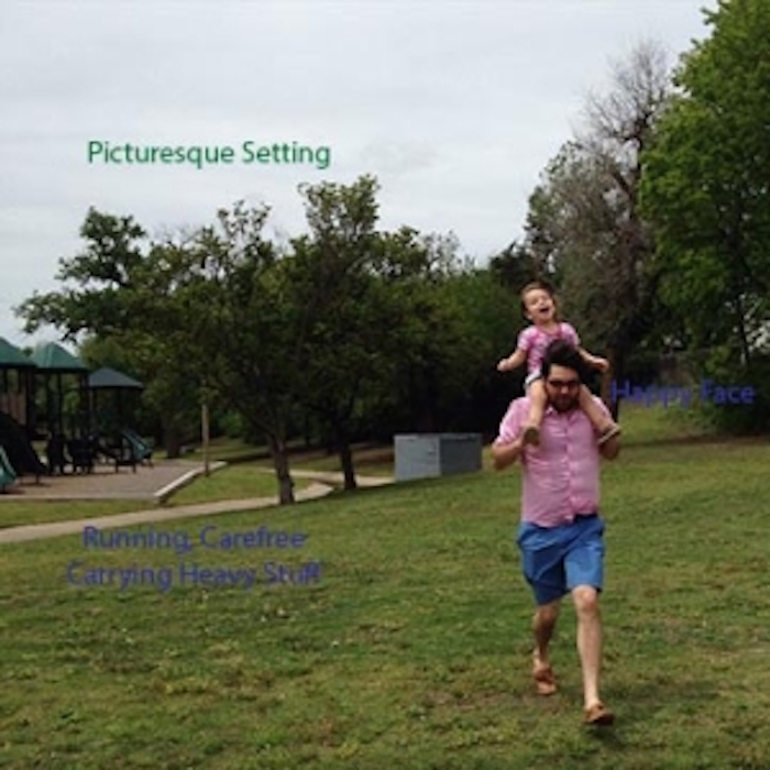 A photo of the author's husband walking in a park with his daughter on his shoulders