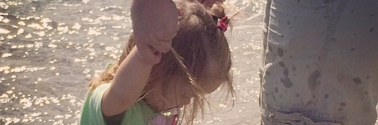 Briann's daughter standing in water