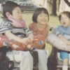 sister with her two siblings with hydrocephalus