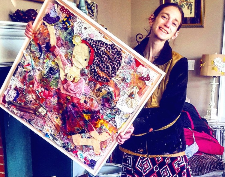 amy holding artwork