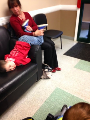 woman in waiting room playing with autistic child