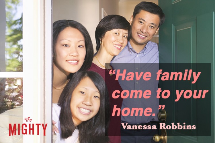 A family smiles as they welcome the viewer opening the door to their home