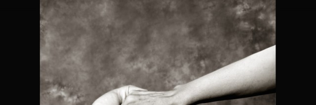 black and white photo of hands grasping each other